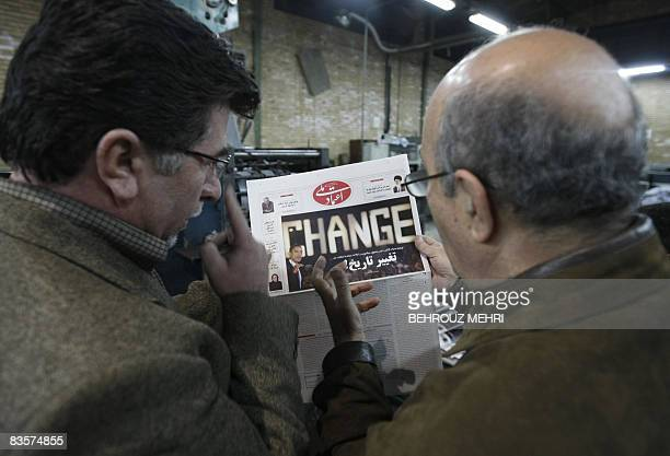 Iranian printing technicians check a printed copiy of Iranian reformist daily Etemade Melli with a picture of US Presidentelect Barack Obama on the...