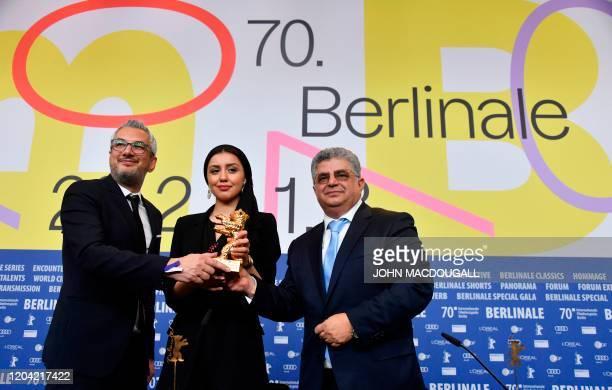 TOPSHOT Iranian producer Farzad Pak Iranian actress Baran Rasoulof and Iranian producer Kaveh Farnam on behalf of Iranian director Mohammad Rasoulof...
