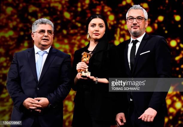 Iranian producer Kaveh Farnam, Iranian actress Baran Rasoulof and Iranian producer Farzad Pak pose with the trophy on behalf of Iranian director...