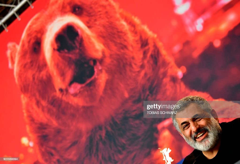 Iranian producer Mani Haghighi attends a press conference to present the film 'Pig' (Khook) presented in competition during the 68th edition of the Berlinale film festival in Berlin on February 21, 2018. / AFP PHOTO / Tobias SCHWARZ