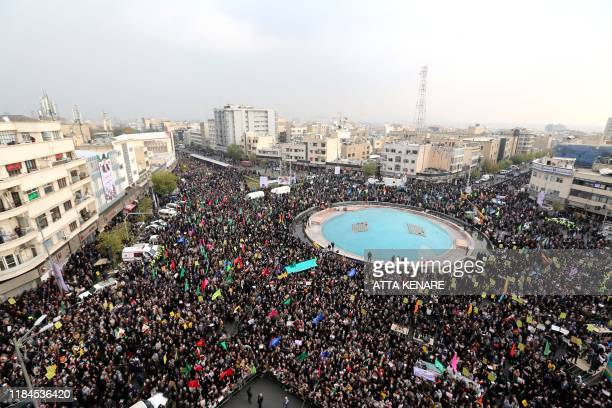 TOPSHOT Iranian progovernment demonstrators gather in the capital Tehran's central Enghelab Square on November 25 to condemn days of rioting that the...