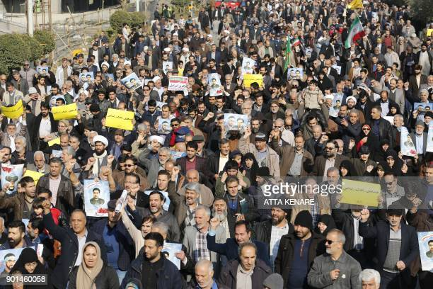 Iranian progovernment demonstrators take part in a march in central Tehran after the weekly Friday prayers on January 5 2018 New proregime protests...