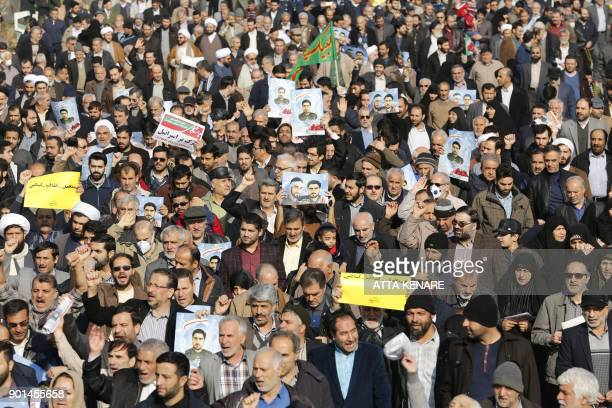 TOPSHOT Iranian progovernment protesters take part in a march held after the weekly Friday prayers in central Tehran on January 5 2018 New proregime...