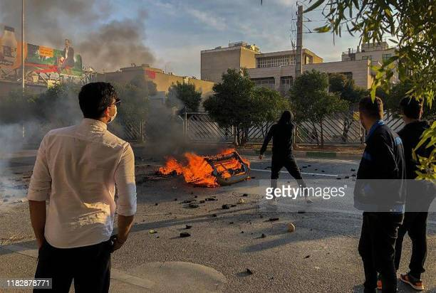 Iranian protesters block a road during a demonstration against an increase in gasoline prices in the central city of Shiraz on November 16 2019 One...