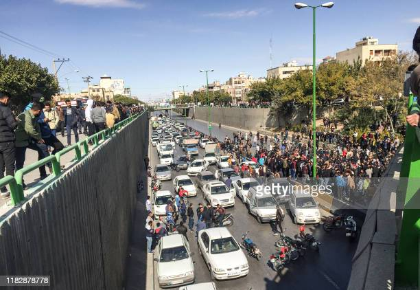 Iranian protesters block a road during a demonstration against an increase in gasoline prices in the central city of Isfahan, on November 16, 2019. -...