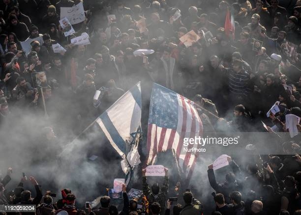 Iranian protesters burn an Israel and the U.S. Flags while attending a mass funeral for the commander of the IRGS Qods Force Qasem Soleimani,...