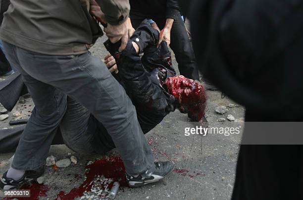 Iranian protesters carry the body of a man who was allegedly shot during an anti-government protest in Tehran on December 27, 2009. Security forces...