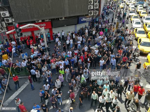 Iranian protesters chant slogans during a demonstration in central Tehran on June 25 2018 Traders in the Iranian capital's Grand Bazaar held a rare...