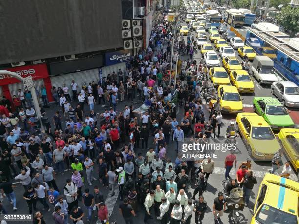 Iranian protesters gather during a demonstration in central Tehran on June 25 2018 Traders in the Iranian capital's Grand Bazaar held a rare protest...