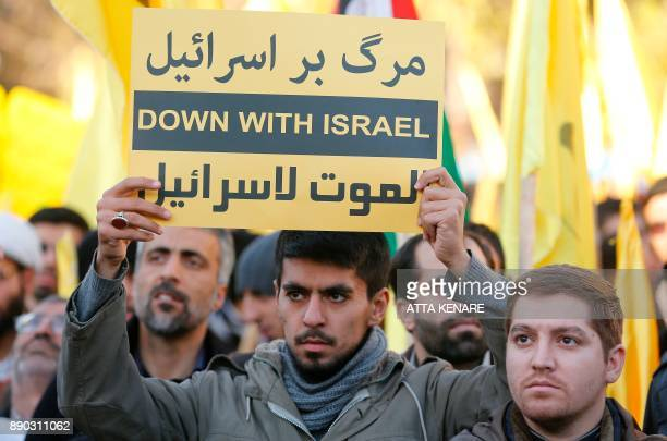 Iranian protesters hold antiIsraeli slogans during a demonstration in the capital Tehran on December 11 2017 to denounce US President Donald Trump's...