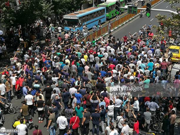 Iranian protesters shout slogans during a demonstration in central Tehran on June 25 2018 Traders in the Iranian capital's Grand Bazaar held a rare...