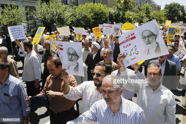 Iranian protestors hold banners in the capital Tehran on May 26 2017 during a demonstration in support of top Bahraini Shiite cleric Isa Qassim who...