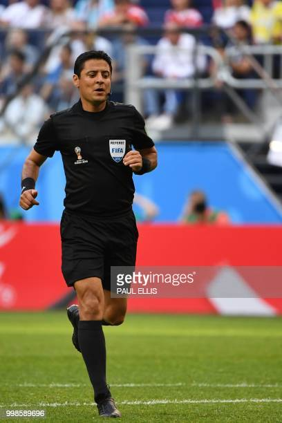 Iranian referee Alireza Faghani runs during the Russia 2018 World Cup playoff for third place football match between Belgium and England at the Saint...