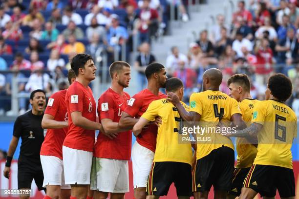 Iranian referee Alireza Faghani shouts as England and Belgium players line up for a corner during their Russia 2018 World Cup playoff for third place...