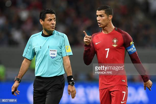 Iranian referee Alireza Faghani speaks with Portugal's forward Cristiano Ronaldo during the 2017 Confederations Cup semifinal football match between...