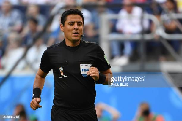 Iranian referee Alireza Faghani watches the teams play during their Russia 2018 World Cup playoff for third place football match between Belgium and...