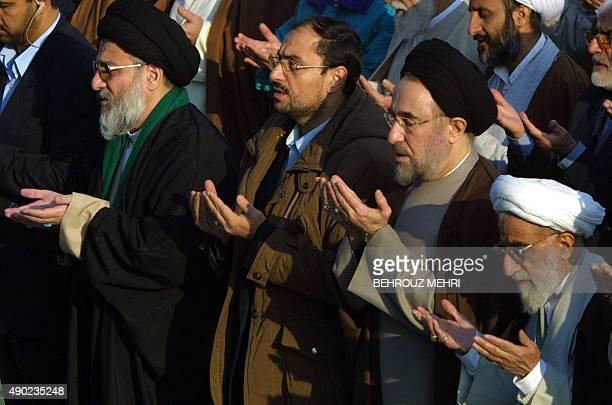 Iranian reformist President Mohammad Khatami performs the Eid alFitr prayer between Ayatollah Ahmad Jannati the head of Iran's conservativedominated...