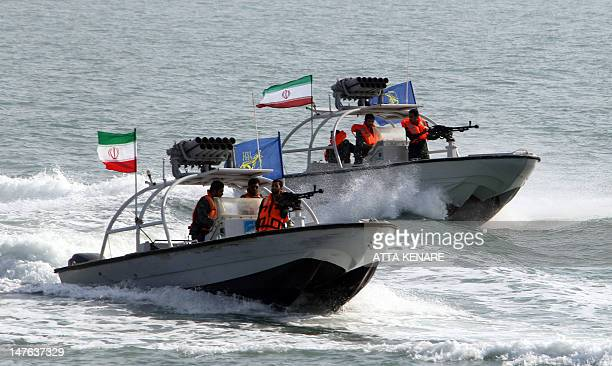 Iranian Revolutionary Guards drive speedboats during a ceremony to commemorate the 24th anniversary of the downing of Iran Air flight 655 by the US...