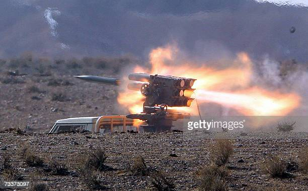Iranian Revolutionary Guards fire a missile from the back of a truck during wargames near Qom 120 km south of Tehran 20 February 2007 The Islamic...
