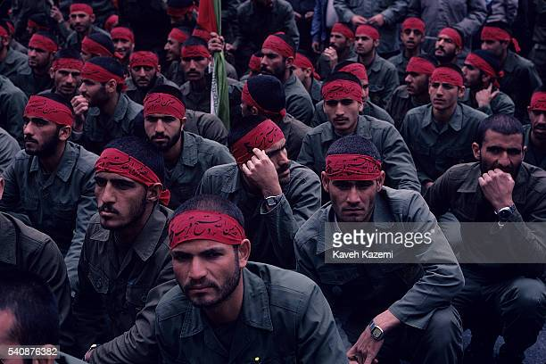 Iranian Revolutionary Guards in red headbands gather in Imam Hussein Square in Tehran, during the Iran-Iraq War, 16th May 1985.