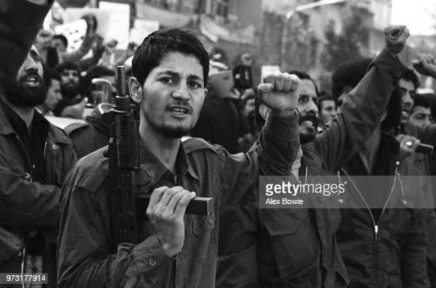 Iranian Revolutionary Guards scream support to colleagues holding 52 US diplomats hostage inside the former US embassy building Tehran 6th November...