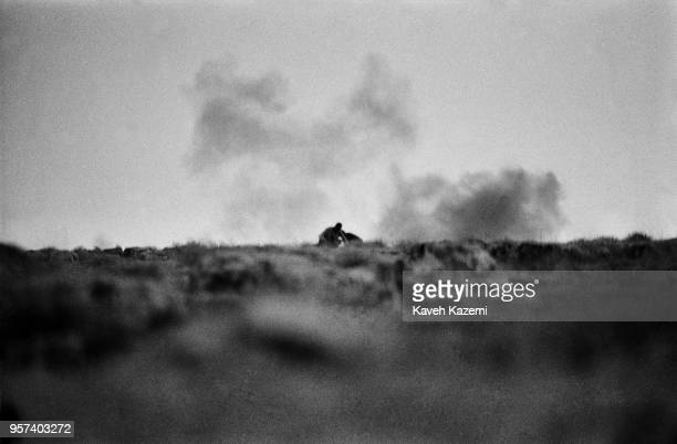 Iranian Revolutionary Guards seen during an operation to salvage the body of a martyred comrade on KoorehMoosh height during heavy shelling by Iraqi...
