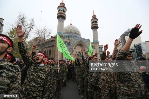 Iranian revolutionary guards take part in an antiUS rally to protest the killings during a US air stike of Iranian military commander Qasem Soleimani...