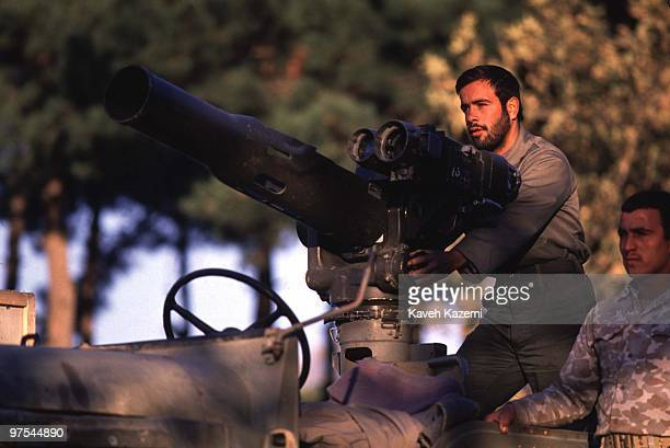 Iranian Revolutionary Guards with an Americanmade TOW antitank missile mounted on a jeep during a military parade in front of the Majlis in Tehran...