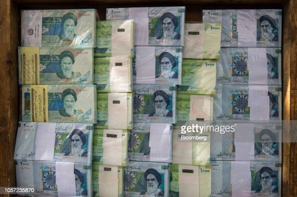 Iranian rial banknotes stand on display at a currency exchange in Tehran Iran on Saturday Nov 3 2018 Irans Supreme Leader Ayatollah Khamenei said US...