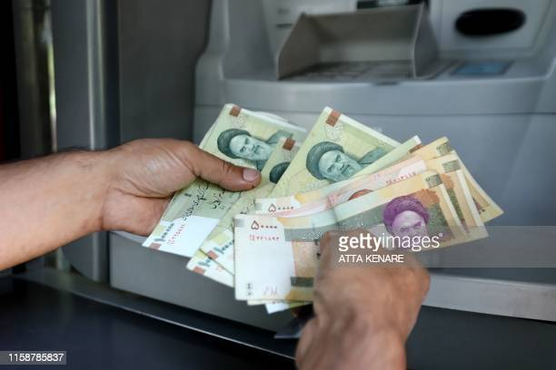 Iranian rials are displayed in Tehran on July 31 2019 The government in sanctionshit Iran on Wednesday approved a plan to remove zeros from the rial...