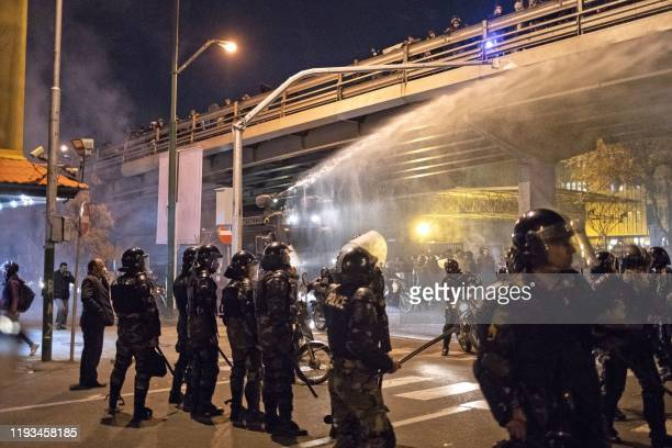 Iranian riot police use a water cannon to disperse protesters during a demonstration outside Tehran's Amir Kabir University on January 11, 2020. -...