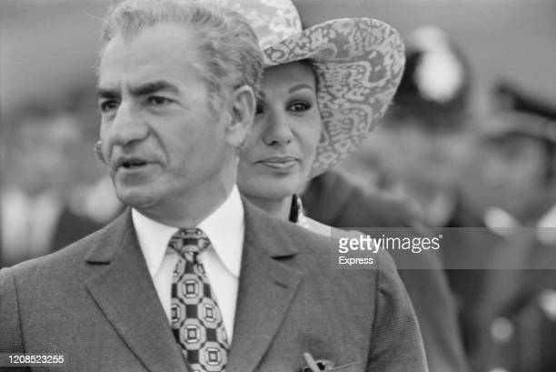 Iranian royal Mohammad Reza Pahlavi , Shah of Iran, and Farah Pahlavi, Shahbanu of Iran, on their arrival for a private visit at Heathrow Airport in...