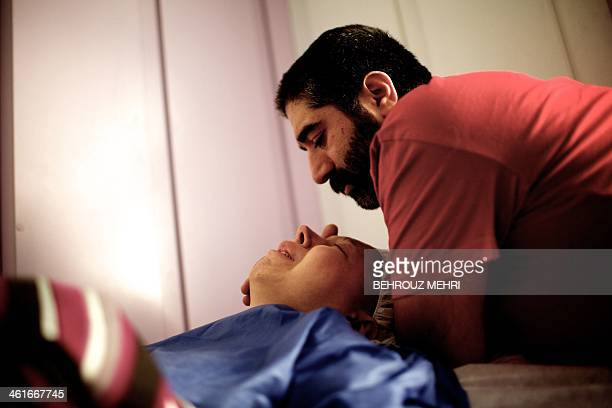Iranian Saleh comforts her fiance a breast cancer patient Farvah after what was supposed to be mastectomy surgery to remove a breast but which was...