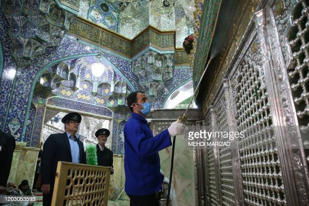 TOPSHOT Iranian sanitary workers disinfect Qom's Masumeh shrine on February 25 2020 to prevent the spread of the coronavirus which reached Iran where...
