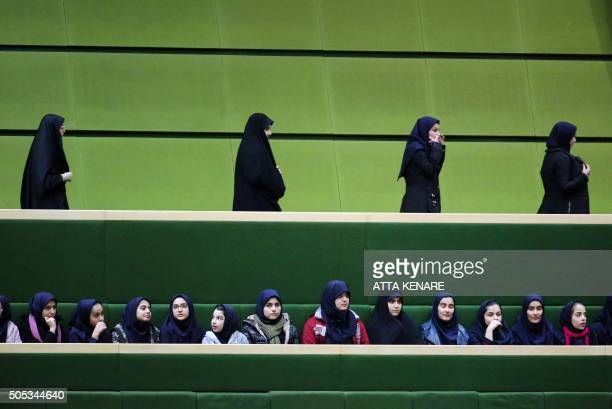 TOPSHOT Iranian schoolgirls attend President Hassan Rouhani's speech to parliament before presenting the proposed annual budget in the capital Tehran...