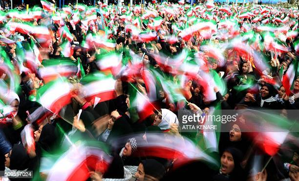 TOPSHOT Iranian schoolgirls wave their national flag during celebrations in Tehran's Azadi Square to mark the 37th anniversary of the Islamic...