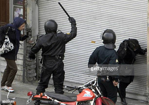 Iranian security forces on motorcycles surround opposition protesters during clashes in Tehran on December 27 2009 Iran security forces killed...