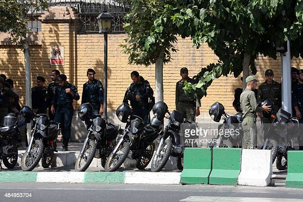 Iranian security forces stand guard outside the British embassy during Britain's Foreign Secretary Philip Hammond's visit on August 23 2015 in the...