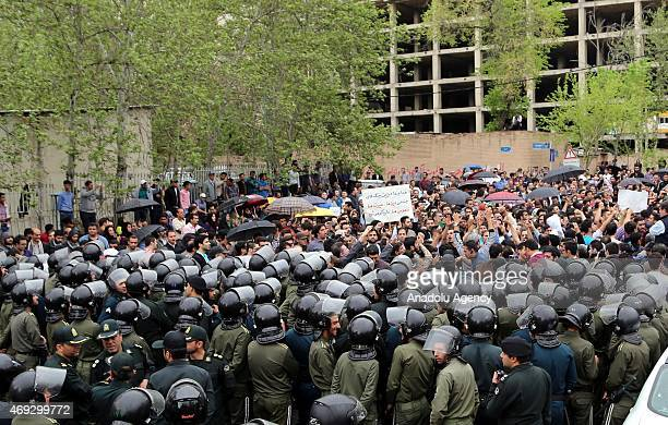 Iranian security officials stand guard as hundreds of Iranians gather outside the Saudi Arabia Embassy in Tehran on April 11 2015 to protest over the...
