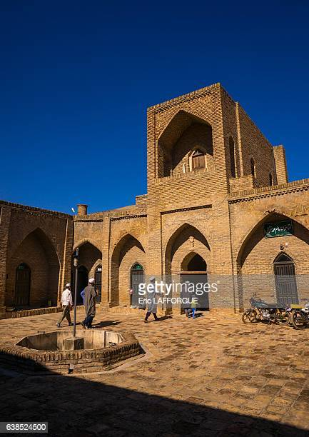 Iranian Shiite men in front of an old caravanserai turned into madrassah on October 18 2015 in Karim Ishan Golestan Province Iran