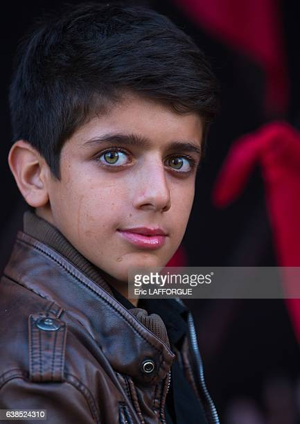 Iranian Shiite muslim boy with green eyes during Muharram on October 21, 2015 in Kashan, Isfahan Province, Iran.