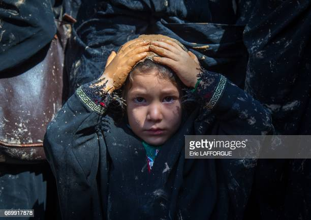 Iranian Shiite muslim girl covered with mud chanting and selfflagellating during Ashura the day of the death of Imam Hussein on October 23 2015 in...