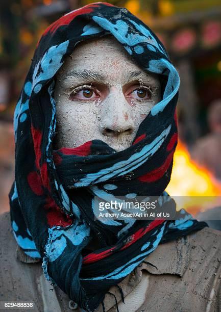 Iranian shiite muslim man after rubbing mud on his body during the Kharrah Mali ritual to mark the Ashura ceremony Lorestan Province Khorramabad Iran...