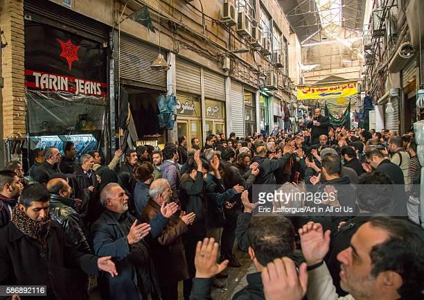Iranian shiite muslim men celebrating ashura in the bazaar central district tehran Iran on December 20 2015 in Tehran Iran