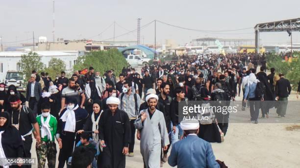 Iranian Shiite Muslim pilgrims enter through the Zurbatiyah border crossing between Iran and Iraq about 90 kilometres east of the city of Kut on...