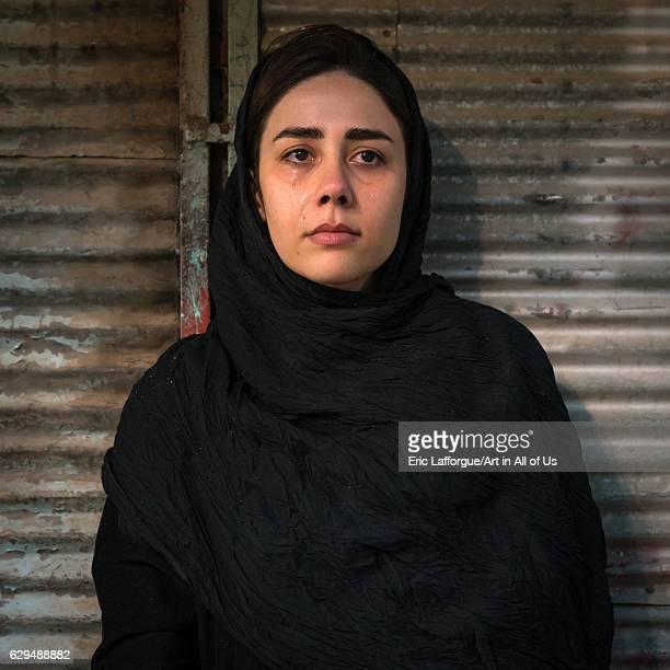 Iranian shiite muslim woman crying during the Kharrah Mali ritual to mark the Ashura ceremony Lorestan Province Khorramabad Iran on October 12 2016...