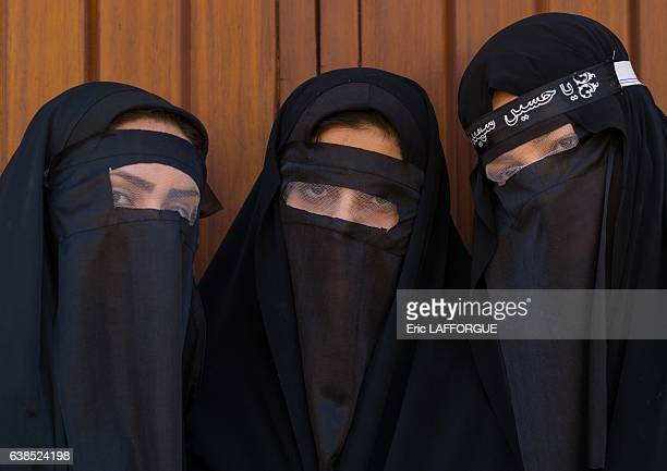 Iranian Shiite muslim women mourning Imam Hussein on the day of Tasua with their faces covered by a veil on October 23 2015 in Khorramabad Lorestan...