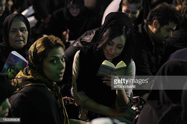 Iranian Shiite Muslim women pray in Tehran in the early hours of August 10 2012 in commemoration of the death of the seventh century Imam Ali bin Abi...
