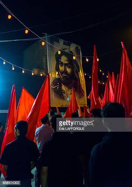 Iranian Shiite muslims men parading with red flags during Ashura the day of the death of Imam Hussein on October 21 2015 in Kashan Isfahan Province...
