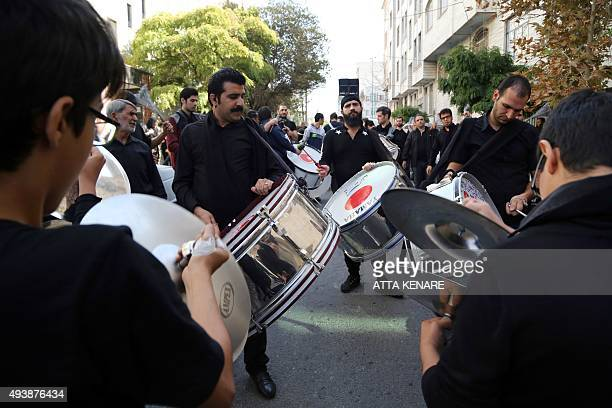 Iranian Shiite Muslims play musical instruments during a ceremony marking Ashura which commemorates the seventh century slaying of Imam Hussein the...
